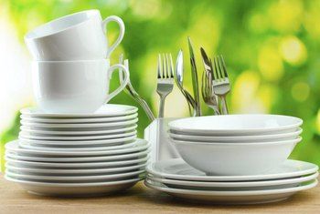 A starter set of dishes usually has place settings for four.