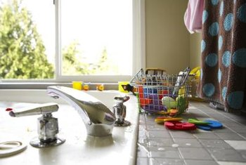 Wiping bathroom surfaces and hanging towels and mats to dry reduce the risk of mold.