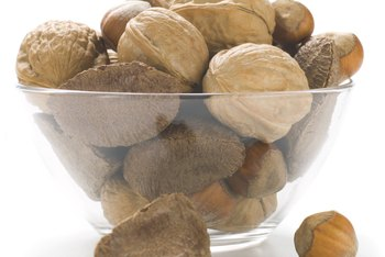 Nutshells add nutrients to soil but are slow to compost.