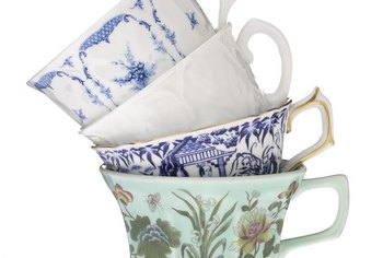 Hand wash antique china to avoid damage to designs and metal treatments.