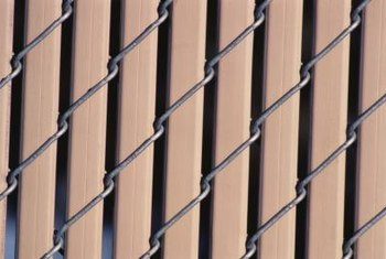 Slats can transform the way a chain-link fence looks.