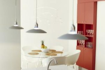 Pairing Bright Orange Paint On The Cabinets Or Walls With White Creates A Striking Modern Look