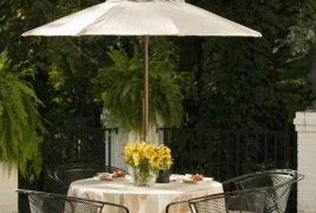 Many iron patio sets come in the umbrella, table and chairs configuration.