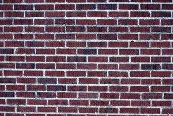 Brick veneers are typically grouted with traditional brick mortar to give them the look of real bricks.