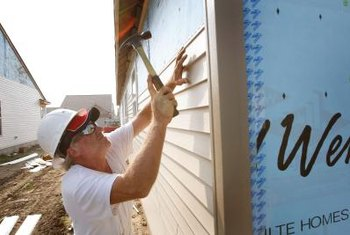 Vinyl siding and trim is held in place by nailing strips.