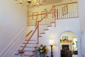 A striking overhead light fixture like a chandelier can add an air of drama to a medium-size foyer.