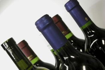Remove any plastic on the neck of the wine bottles.