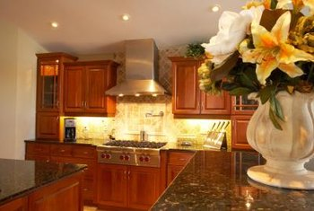 Refinished cabinets can give a fresh look to a tired kitchen.