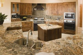 A cultured stone backsplash adds pattern and detail to a kitchen design.