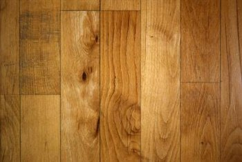 Oak flooring has knots mixed with visually appealing grains.