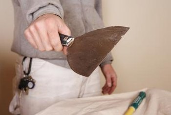 Use a 12-inch drywall knife to apply the drywall compound.