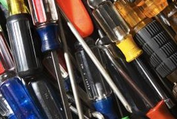Try various types and sizes of screwdrivers to find one that might work.
