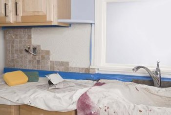 How To Tile Under Cabinets Painter S Tape And A Drop Cloth Protect The Countertop From Thinset Grout