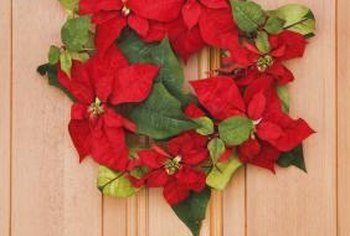 Removable adhesive hooks give you an alternative to nails for hanging Christmas decor.