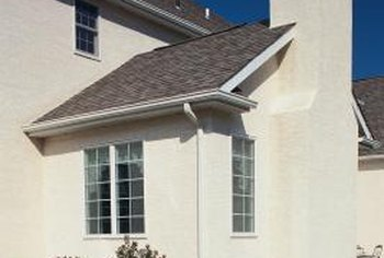 Chimneys for fireplace units are covered with siding, stucco or masonry veneer.