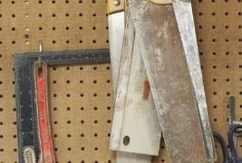 Pegboard hooks are a good way to hang smaller tools.