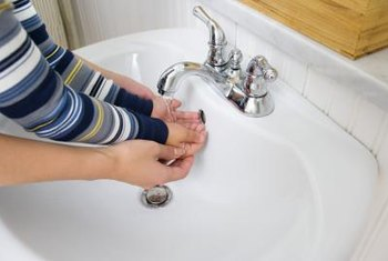 Installing a faucet in a pedestal sink is not difficult.