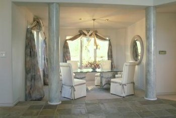 A simple pair of pillars on each side of the room can effectively divide a space.