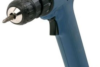 Use a screw gun to remove the mounting screws from cement backer board.