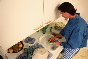 An air gap typically sits to the right of a kitchen sink on the counter.