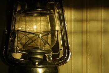 Vintage hurricane lamps have nautical flair that complements beach-inspired decor.