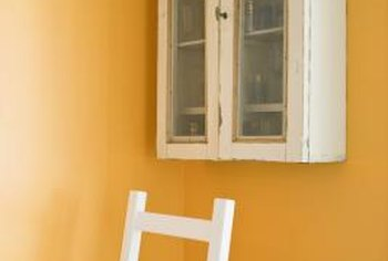 Pairing your tangerine walls with neutral shades like crisp white helps tone down the brightness.