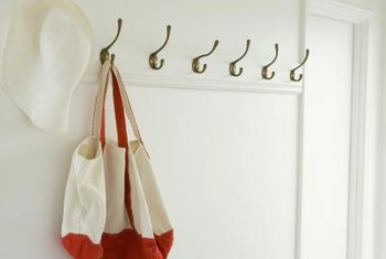 Repurpose coat hooks, cup hooks, brackets and magnets for tieback holders.