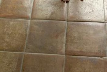 Apply a finishing sealer coat to the entire surface after grout dries.