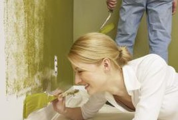 Backup masking and careful painting protects carpets.