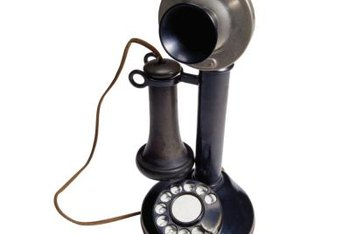 A candlestick phone complements a '20s retro look.