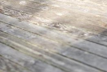 Power washing is an efficient way to get the gray out of a wood deck.