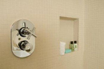 A recess provides attractive and convenient storage space within a shower.