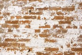 Old brick walls are often covered with plaster.