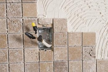 Install a tumbled tile backsplash over painted drywall or cement backerboard.