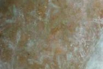 Several colors of paint atop a metallic finish create a faux patina.