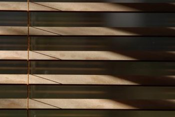 Stain wood blinds to give them a new look.