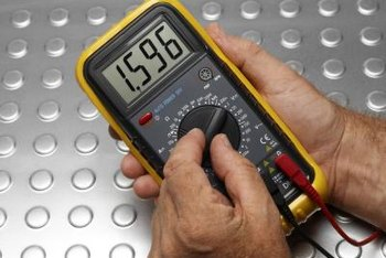 A digital ohmmeter is used to diagnose door switch problems.