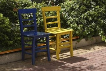 Refinishing your chairs in a bright paint shade can give them new life.