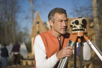 A surveyor uses a theodolite to measure angles and help set marker spots.