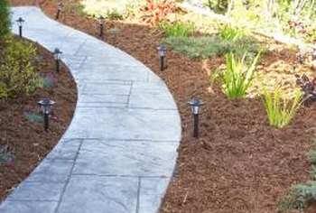 Make an etched concrete walkway resemble a tiled one.