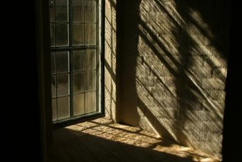 An aluminum window or door frame is often nailed to the wall behind the brick.