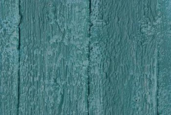 Teal paint brings an old wooden door or piece of furniture into the present.