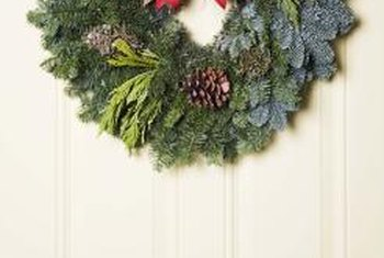 A wreath is one form of holiday decor you can create with faux greenery.