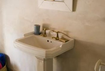 A pedestal sink adds sleek style to a bathroom.