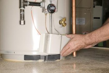 The thermocouple on a gas water heater is inside the burner assembly, next to the pilot tube.