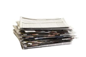 A single newspaper page can make three or more pots.