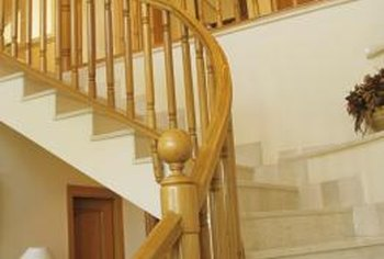 Wooden balusters and newel posts support a classic wood handrail.