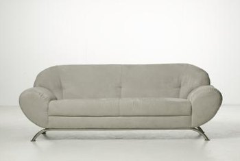 A white sofa has a modern design element.