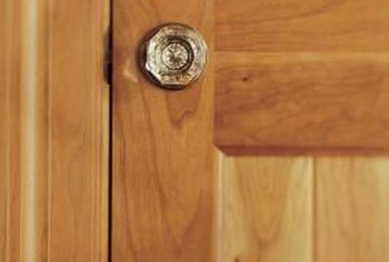 The working parts of a doorknob are hidden within the door.