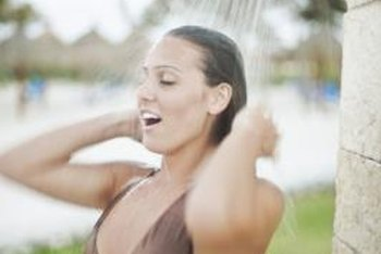 A free-standing stall around your outdoor shower will keep you warmer.